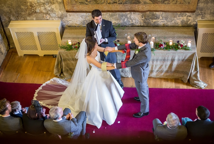 Newlyweds handfasting in Dundas Castle, Scotland