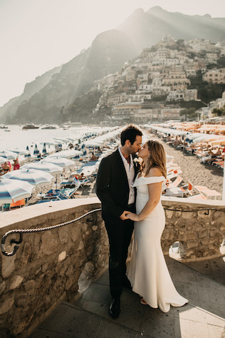 Newlyweds in front of beach in Positano, Italy