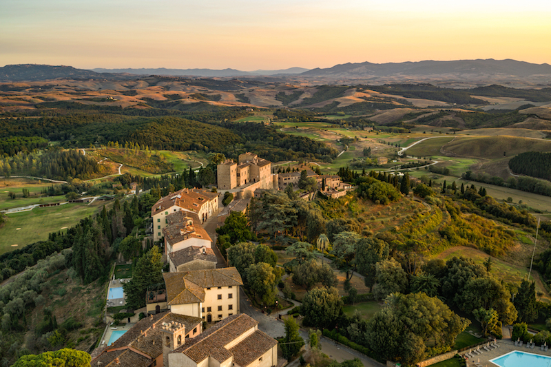 Rolling hills of Tuscany with Toscana Resort Castelfalfi arial view