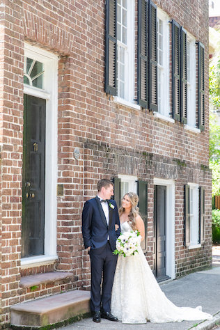 couple in front of brick wall