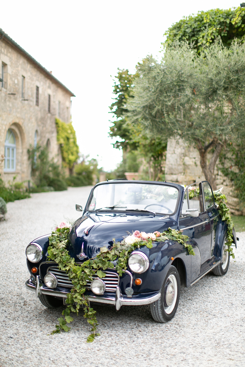 Navy Morris Minor decorated for a wedding