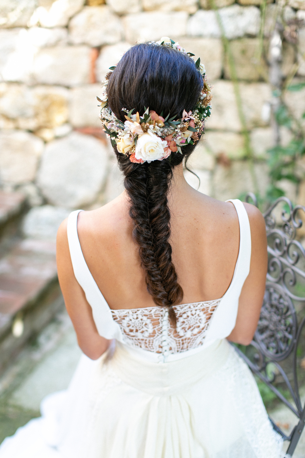 bride with flower crown and fishtail braid